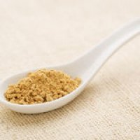 ginger-root-powder-white-chinese-spoon-against-burlap-canvas-45280073